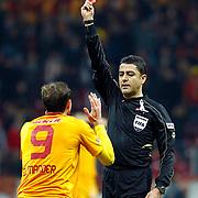 Referee's Bulent Yildirim show the red card to Galatasaray's Johan Elmander (L) during their Turkish Superleague soccer match Galatasaray between Sivasspor at the Turk Telekom Arena at Aslantepe in Istanbul Turkey on Saturday 26 November 2011. Photo by TURKPIX