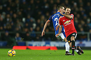 Juan Mata of Manchester United passes the ball under pressure from Morgan Schneiderlin of Everton . Premier league match, Everton v Manchester Utd at Goodison Park in Liverpool, Merseyside on New Years Day, Monday 1st January 2018.<br /> pic by Chris Stading, Andrew Orchard sports photography.