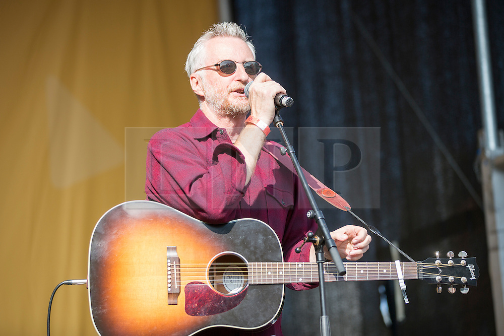 © Licensed to London News Pictures. 04/10/2015. Manchester, UK. Picture shows Billy Bragg at the Anti Austerity protest in Manchester expected to attract thousands of people to protest against Austerity cuts at the start of the Conservative Party Conference in the city. Photo credit: Andrew McCaren/LNP