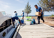 INDONESIA, Karimunjawa Archipelago, Kura Kura Resort, loading food and goods for the guests at Krakal Kecil, the private island for few guesys only with no runnig water or electricity.