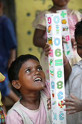 ARPANA PRIYADARSINI 5 years old playing with blocks that are coloured with shapes and letters. GOPINATHPUR Village is a coastal community of fishermen that was originally reserved for lepers many years back. They are still marginalised by this tradition and their lowly status in the caste system. This is one of many supported kindergartens that PREM works with in villages in Orissa and Andhra Pradesh states of India.