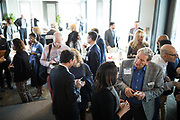 Attendees socialize during the Business of Cannabis event at the Silicon Valley Capital Club in San Jose, California, on April 4, 2019. (Stan Olszewski for Silicon Valley Business Journal)