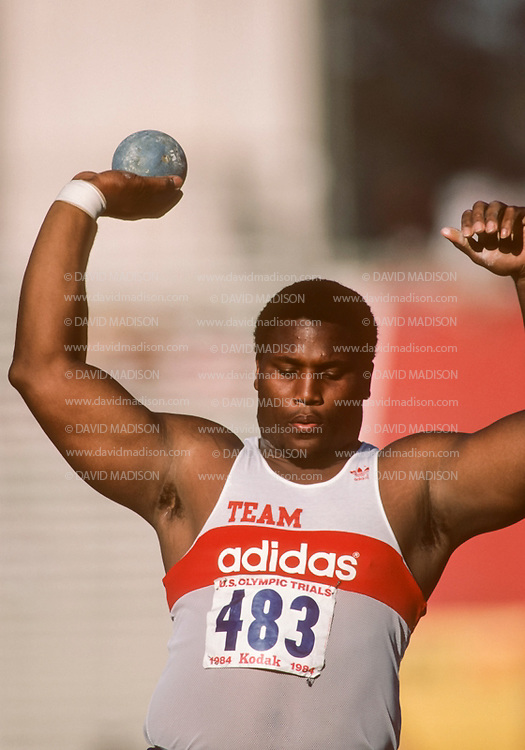 LOS ANGELES -  JUNE 23:  Michael Carter of the USA competes in the Men's Shot Put event of the United States 1984 Olympic Trials for Track and Field held on June 23, 1984 in the Los Angeles Coliseum in Los Angeles, California. (Photo by David Madison/Getty Images) *** Local Caption *** Michael Carter
