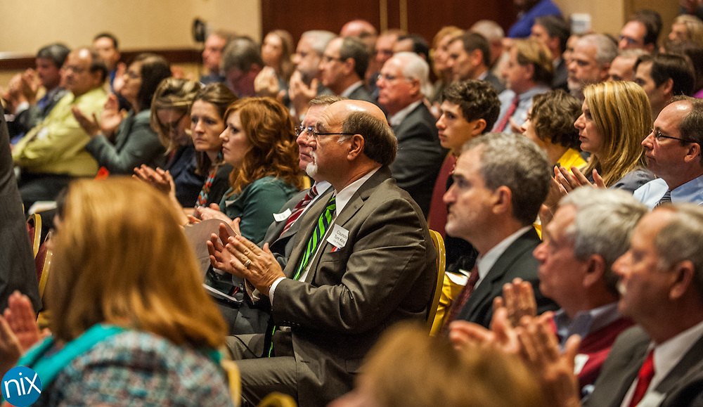 Community leaders applaud during a State of the Region Summit hosted by the Cabarrus Regional Chamber of Commerce Thursday morning at Embassy Suites in Concord.
