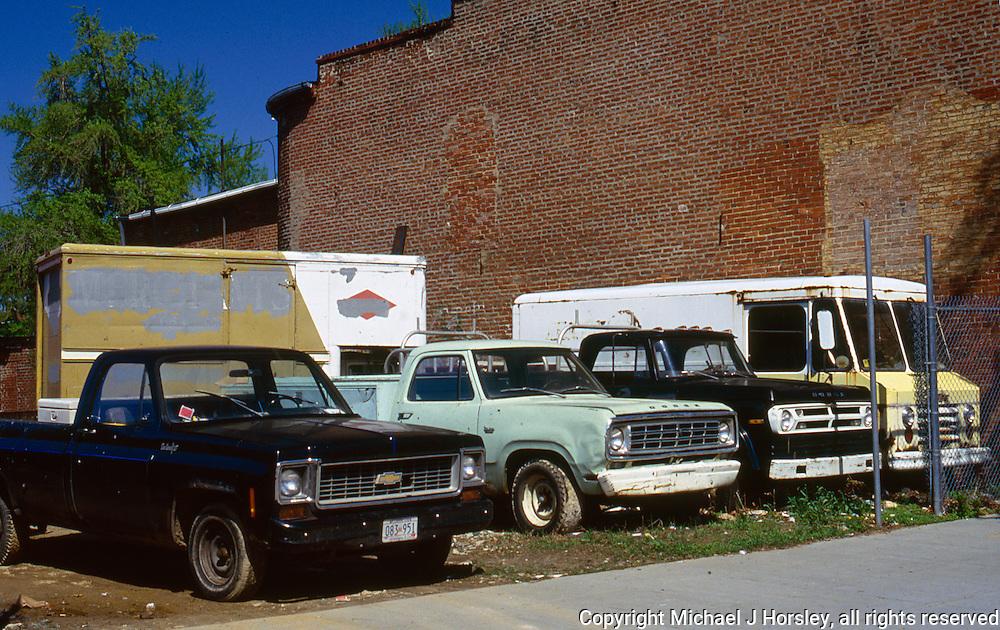 A fine assortment of utility trucks. 14th Street Vacant lot NW Washington DC