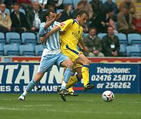 Photo: Ian Hebden.<br /> Coventry City v Cardiff City. Coca Cola Championship. 30/04/2006.<br /> Cardiffs Riccardo Scimeca (R) fends off Coventrys Don Hutchinson (L).