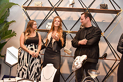 Left to right, Eva Fehren, Liza Urla and Nicholas Kirkwood at a party hosted by Nicholas Kirkwood and Eva Fehren to celebrate Part 2 in the Nicholas Kirkwood presents series held at Nicholas Kirkwood, 5 Mount Street, London England. Eva Fehren is a fine jeweller, born and raised in New York City. Her collections are both inspired and created in the city, and via the Nicholas Kirkwood store, it is the first opportunity to view and shop the collection in London. 9 November 2017.