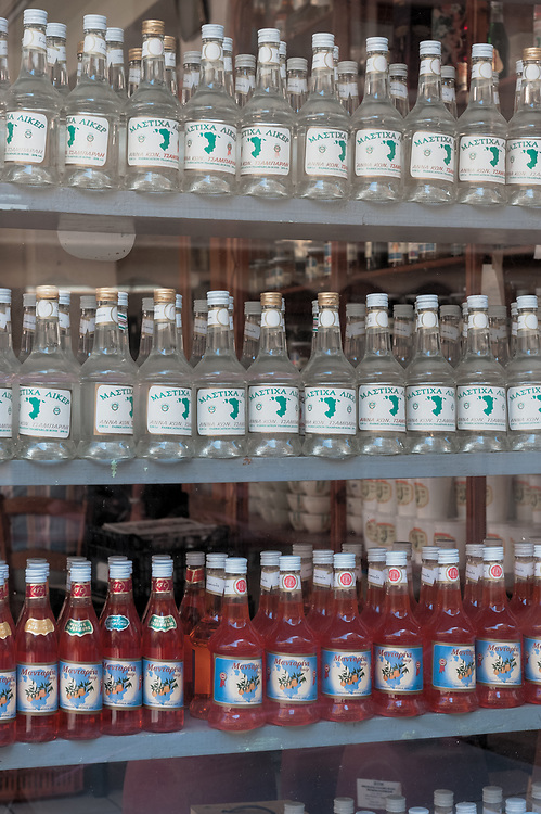 Bottles of traditional Mastic Liqueur and Tangerine Liqueur at the old shop of Tsamparlis Distillery in Chios town. The distillery was founded in 1914 and it still run by the same family.