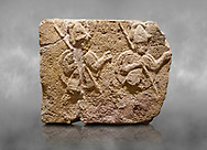Hittite relief sculpted orthostat stone panel of Long Wall Limestone, Karkamıs, (Kargamıs), Carchemish (Karkemish), 900-700 B.C. . Anatolian Civilisations Museum, Ankara, Turkey. Two helmeted soldiers in short skirt carry shield on their backs and spear in their hands.<br /> <br /> On a grey art background. .<br />  <br /> If you prefer to buy from our ALAMY STOCK LIBRARY page at https://www.alamy.com/portfolio/paul-williams-funkystock/hittite-art-antiquities.html  - Type  Karkamıs in LOWER SEARCH WITHIN GALLERY box. Refine search by adding background colour, place, museum etc.<br /> <br /> Visit our HITTITE PHOTO COLLECTIONS for more photos to download or buy as wall art prints https://funkystock.photoshelter.com/gallery-collection/The-Hittites-Art-Artefacts-Antiquities-Historic-Sites-Pictures-Images-of/C0000NUBSMhSc3Oo