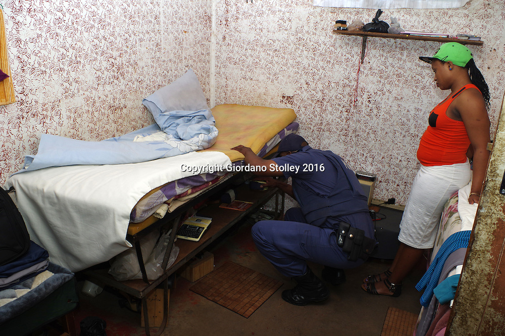 DURBAN - 13 May 2016 - Police officers search the room of a ressident (right) at Durban's notorious Glebelands Hostels. They were looking for weapons, drugs and stolen goods. Hundreds of police officers from Durban, the KwaZulu-Natal south coast, Pretoria and the eThekwini Metro Police forces converged on the violent Glebelands Hostels on the edge of Durban's Umlazi township, which have seen numerous shootings that have leftt at least 61 people dead and scores injured. Picture: Allied Picture Press/APP