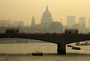 Crossing transport over Waterloo Bridge during London summer smog during heatwave in UK's capital.
