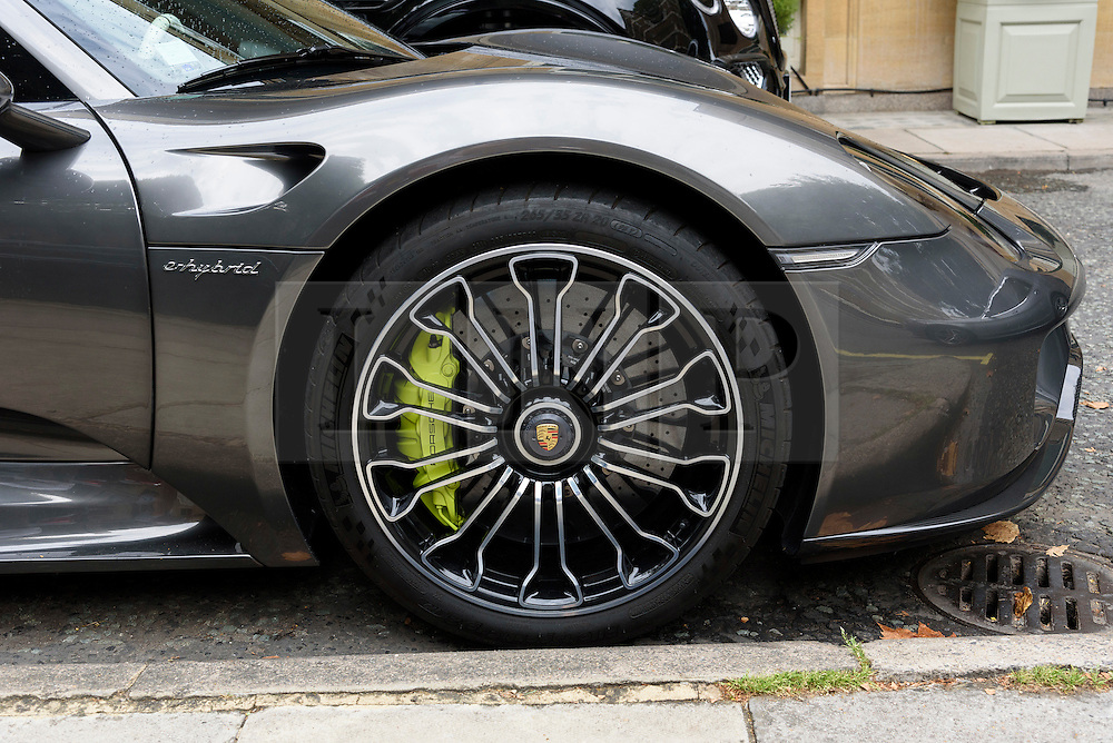 © Licensed to London News Pictures. 25/08/2016.  A fleet of supercars including Porsche 918 Spyder is parked in Knightsbridge.  The cars are believed to be owned by Quatar Sheikh Khalifa bin Hamad bin Khalifa Al-Thani otherwise know as KHK. London, UK. Photo credit: Ray Tang/LNP