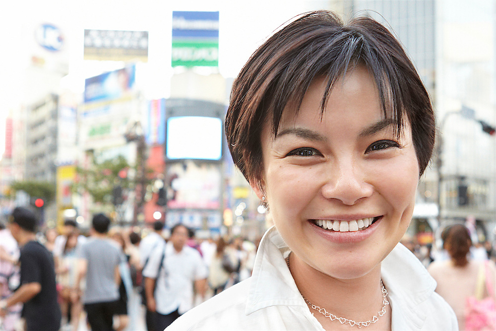 Portrait photograph of smiling Japanese business woman in Shibuya Tokyo