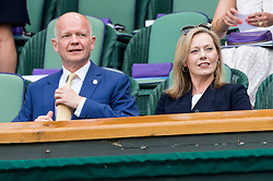© Licensed to London News Pictures. 05/07/2019. London, UK.  Lord Hague and Lady Hague of Richmond watch centre court tennis in the royal box on Day 5 of Wimbledon Tennis Championships 2019 held at the All England Lawn Tennis and Croquet Club. Photo credit: Ray Tang/LNP