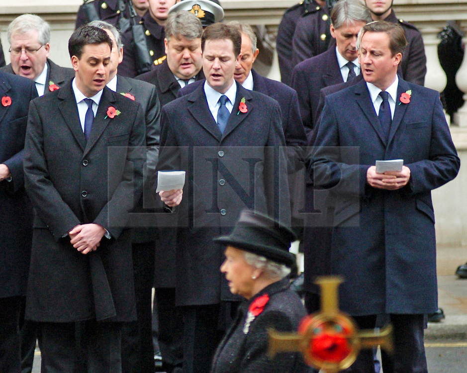 (c) London News Pictures. 14/11/2010. SINGING FROM THE SAME HYMN SHEET. Labour Leader Ed Miliband borrows Deputy Prime Minister Nick Clegg share a hymn sheet as The Queen leds the Remembrance Sunday service at the Cenotaph in London in honour of those who have died in wars and conflicts..Pictured - Labour Leader Ed Miliband borrows Deputy Prime Minister Nick Cleggs hymn sheet during the Remembrance Sunday service at the Cenotaph
