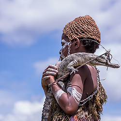 Crocodile Festival Ambunti 2018. Known as one of the largest rivers in the Asia-Pacific region theSepik River is home to some of the world's largest freshwater and saltwater crocodile populations. The Sepik River Crocodile Festival highlights the importance of the crocodile and its cultural significance to the people of the Sepik River. The Crocodile symbolizes strength, power and manhood. Skin-cutting initiations continue in Sepik River communities where men proudly wear scars cut into their skin during the rite of passage. These scars, resembling the back of a crocodile, run from the shoulder to the hip. Crocodiles are significant to the Sepik culture where they have cultural traditions, beliefs and legends based on this ancient animal.