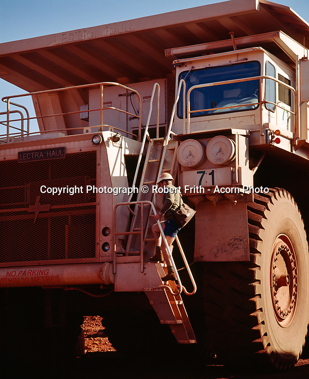 Haulpak driver climbing to the cab at Tom Price minesite