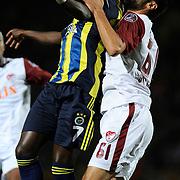 S.B. Elazigspor's Sedat Bayrak (L) and Fenerbahce's Moussa Saw in action with ball during their Turkish superleague soccer match S.B. Elazigspor between Fenerbahce at the Ataturk stadium in izmir Turkey on Saturday 18 August 2012. Photo by TURKPIX