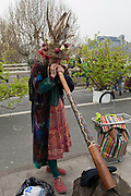 A Climate Change activist with Extinction Rebellion campaigner plays the didgerido for a better future for planet Earth after blocking Waterloo Bridge and as part of a multi-location 5-day Easter protest around the capital, on 16th April 2019, in London, England.