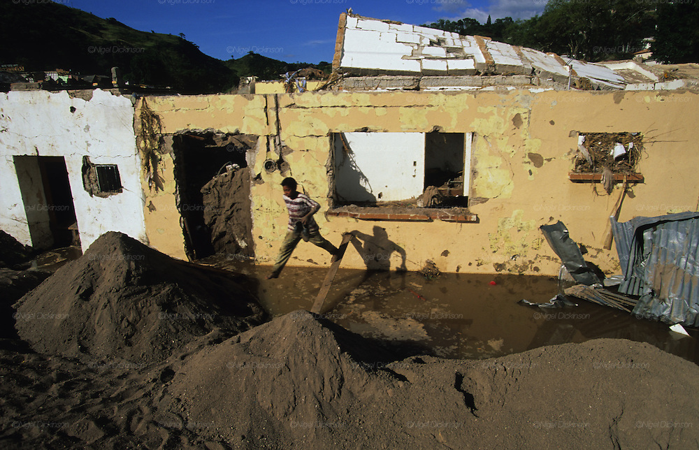 Central America, Honduras, Tegucigalpa. Devastation in the aftermath of Hurricane Mitch. High winds and flooding. Refugees. Street Children roaming the streets. Infrastructure destroyed.
