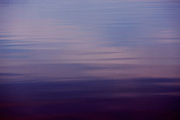 deep purple and pink tones of sunset rests on the pacific ocean waters