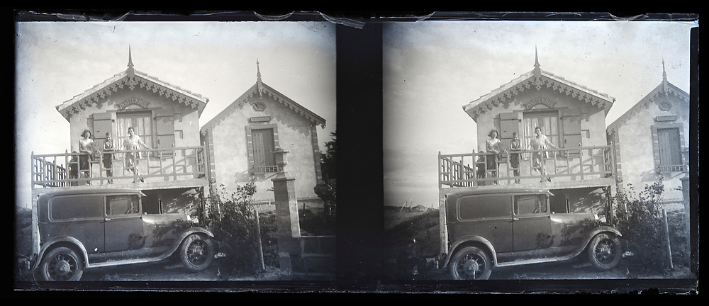 posing with car and vacation house 1920s France