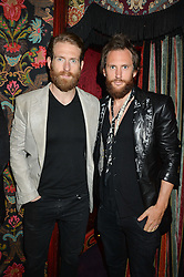 Left to right, CRAIG McGINLAY and MARC JACQUES BURTON at a party hosted by fashion website Farfetch to launch i.am + EPs headphones hosted by Will.i.am at Loulou's, 5 Hertford Street, London on 16th September 2016.