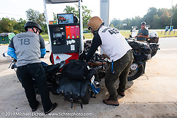 Gary Shorman and Jeff Durrant fillat a gas stop during the Cross Country Chase motorcycle endurance run from Sault Sainte Marie, MI to Key West, FL. (for vintage bikes from 1930-1948). Stage-7 covered 249 miles from Macon, GA to Tallahassee, FL USA. Thursday, September 12, 2019. Photography ©2019 Michael Lichter.