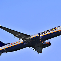 Ryanair Boeing 737 taking off from Cork Airport at dusk.<br /> Aviation and Aerial Photography by John Allen