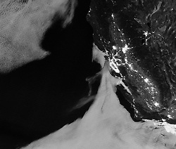 "July 5, 2018 - San Francisco, California, U.S. - Light from the County Fire illuminated the night skies of Northern California when the Suomi NPP satellite acquired this image overnight on July 1, 2018. With plenty of light from a nearly full Moon, the smoke was even visible streaming southwest toward San Francisco Bay and the Pacific Ocean. This nighttime image was acquired with the ""day night band"" of the Visible Infrared Imaging Radiometer Suite (VIIRS) on Suomi. (Credit Image: © NASA Earth Observatory/ZUMA Wire/ZUMAPRESS.com)"