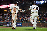San Francisco Giants left fielder Jarrett Parker (6) high fives San Francisco Giants third baseman Pablo Sandoval (48) after scoring a run against the Milwaukee Brewers at AT&T Park in San Francisco, California, on August 21, 2017. (Stan Olszewski/Special to S.F. Examiner)