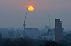 © Licensed to London News Pictures 02/03/2021. Greenwich, UK. A view of the sunset from the park. People get out of their homes from a third national Coronavirus lockdown to enjoy the sunset in Greenwich Park, London. Photo credit:Grant Falvey/LNP