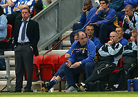 Photo: Paul Thomas.<br />Wigan Athletic v Portsmouth. The Barclays Premiership. 29/04/2006.<br /><br />Portsmouth manager Harry Redknapp (L), his staff and players look dejected as Wigan take the lead.