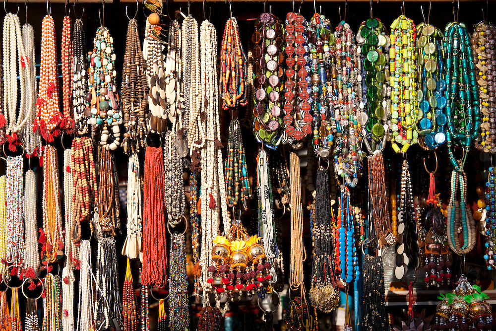 Traditional beads and necklaces on market stall in street scene in city of Varanasi, Benares, Northern India