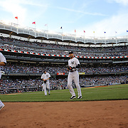 Derek Jeter, New York Yankees, heads back to the dugout after the first inning during the New York Yankees Vs Cincinnati Reds baseball game at Yankee Stadium, The Bronx, New York. 18th July 2014. Photo Tim Clayton