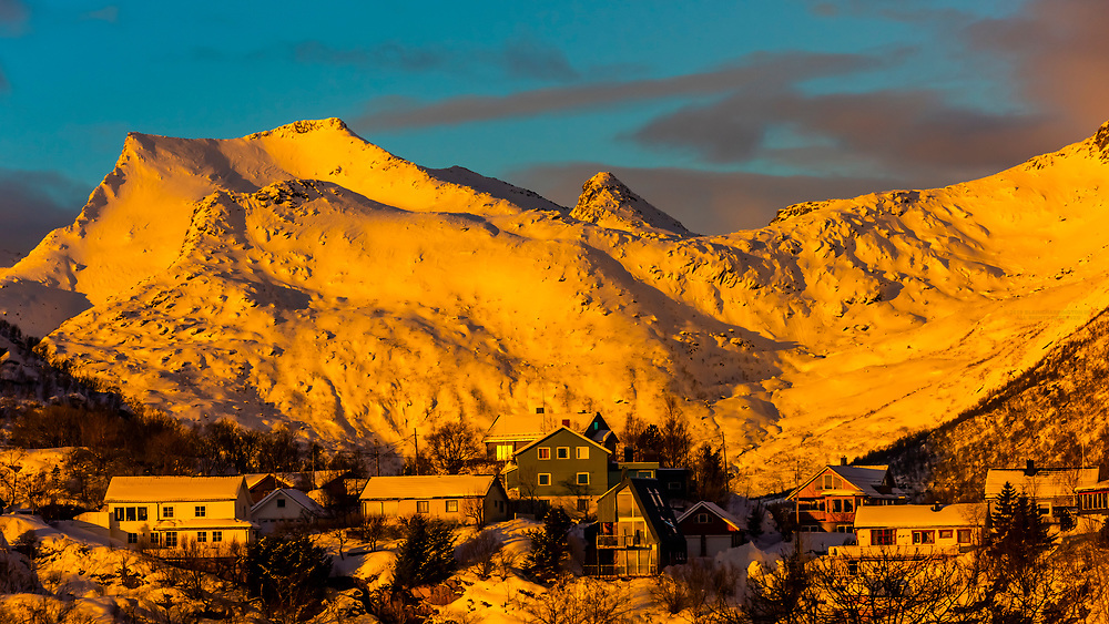 Houses surrounded by snowcapped mountains inSvolvaer, on Austvagoya Island, Lofoten Islands, Arctic, Northern Norway.