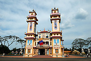 Cao Dai temple in Tay Ninh. Cao Dai (full name Dai Dao Tam Ky Pho Do), is the third largest religion in Vietnam, and this is its main temple, the Tay Ninh Holy See, in Tay Ninh, Vietnam