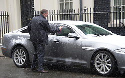 The Prime Minister's car being cleared of snow by his detective before he made his way to the commons today to make a statement on the Algerian crisis, whilst guarding No 10 Downing Street, London, UK, January 18 2013. Photo by  i-Images.