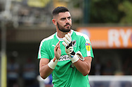 AFC Wimbledon goalkeeper Tom King (1) clapping during the EFL Sky Bet League 1 match between AFC Wimbledon and Coventry City at the Cherry Red Records Stadium, Kingston, England on 11 August 2018.