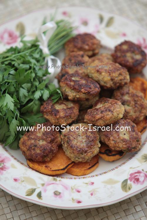 Meat cutlets on sweet potato