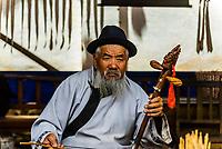 Naxi (ethnic minority) musicians performing in the ancient village of Baisha, near Lijiang, Yunnan Province, China.