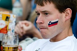Sad slovenian fan in Ljubljana during the 2010 FIFA World Cup South Africa Group C Third Round match between Slovenia and England on June 23, 2010, in Ljubljana, Slovenia. (Photo by Matic Klansek Velej / Sportida) / SPORTIDA PHOTO AGENCY