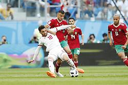(l-r) Alireza Jahanbakhsh of IR Iran, Ghanem Saiss of Morocco, Karim El Ahmadi of Morocco