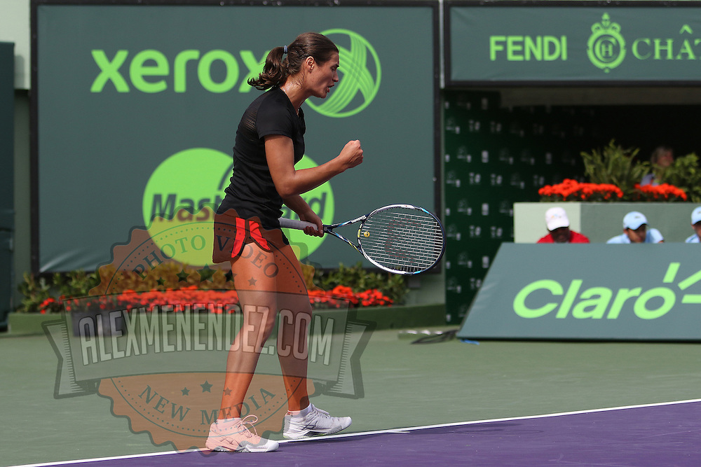 Monica Niculescu, of Romania, pumps her fist during a match against Serena Williams of the United States at the Miami Open tennis tournament on Saturday, March 28, 2015 in Key Biscayne, Florida. (AP Photo/Alex Menendez)