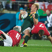 Shalk Burger, South Africa, is tackled by Danny Lydiate, (left) and Sam Warburton (right) during the Wales V South Africa, Pool D match during the Rugby World Cup in Wellington, New Zealand,. 11th September 2011. Photo Tim Clayton
