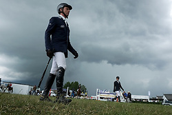 © Licensed to London News Pictures. <br /> 08/07/2014. <br /> <br /> Harrogate, United Kingdom<br /> <br /> Riders walk towards their horses as they exercise prior to competing on the first day of the Great Yorkshire Show. The show is England's Premier Agricultural Event and is based on the 250-acre Great Yorkshire Showground near Harrogate. The Main Ring is the hub of the Show providing a setting for international show jumping and world class cattle parade. The showground is filled with animals, country demonstrations, have-a-go activities and rural crafts.<br /> <br /> Photo credit : Ian Forsyth/LNP