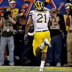January 3, 2012; New Orleans, LA, USA; Michigan Wolverines wide receiver Junior Hemingway (21) runs in for a touchdown against the Virginia Tech Hokies during the second quarter of the Sugar Bowl at the Mercedes-Benz Superdome.  Mandatory Credit: Derick E. Hingle-US PRESSWIRE