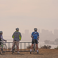 Bicyclists view Alcatraz Island and San Francisco from Angel Island State Park in San Francisco Bay, California.