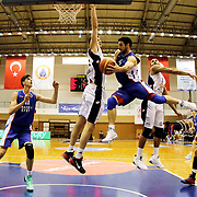 Anadolu Efes's Emircan Kosut (2ndL) and Dogus Balbay (3ndR) during their Turkish Basketball League match Istanbul BSB between Anadolu Efes at Cebeci Arena in Istanbul Turkey on Monday 09 March 2015. Photo by Aykut AKICI/TURKPIX