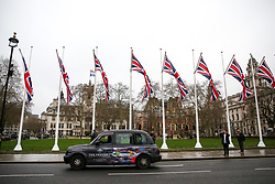 © Licensed to London News Pictures. 30/01/2020. London, UK. Union flags flutter in Parliament Square as UK prepares to leave the European Union at 11pm on the 31 January 2020. Thereafter will be a transition period until the end of 2020, while the UK and EU negotiate additional arrangements. Photo credit: Dinendra Haria/LNP